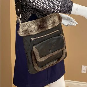 Cross body purse with faux fur accents